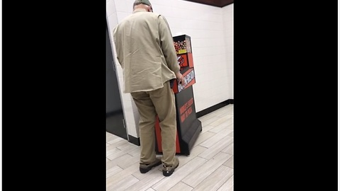 Overly Excited Elderly Man Is Deep Into The Arcade Game