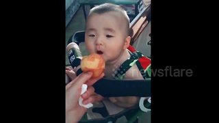 Baby has cutest reaction looking at a peach - Video