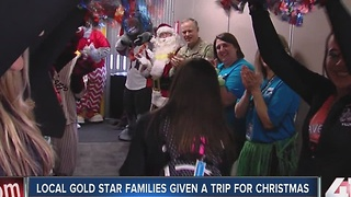 Families of fallen heroes get holiday gift - Video