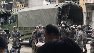 Chinese Army Helps Clean Up in Macau After Typhoon Hato - Video