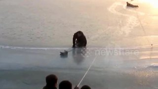 Firefighters rescue elderly man trapped on frozen river - Video
