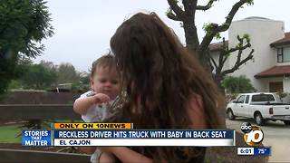 Reckless driver hits truck with baby in back seat - Video