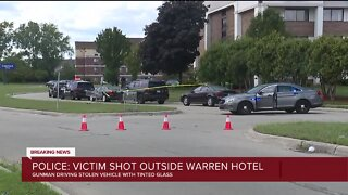 Police say 18-year-old shot outside a hotel