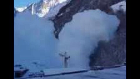 Controlled Avalanche Surges Down Swiss Mountain
