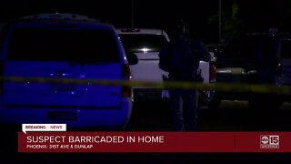 Suspect barricaded in home near 31st Avenue and Dunlap