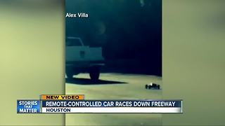 Remote controlled car is video-recorded driving on highway in Texas - Video