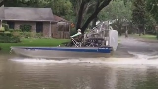 Airboat Speeds Through Flooded Houston Suburbs - Video