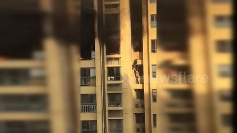 Two residents forced to jump to lower floor to escape high-rise fire