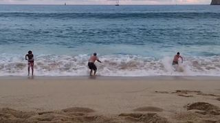 A Large Wave Knocks Down A Family On The Beach - Video