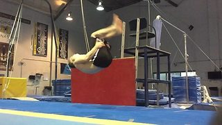 A 20-Year-Old Gymnast Performs Incredible Seated Back-Flip - Video