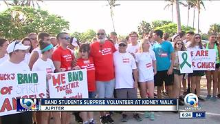 Band students surprise volunteer at kidney walk - Video