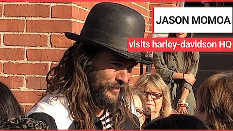 Jason Momoa very enthusiastically greeting workers at the Harley-Davidson HQ