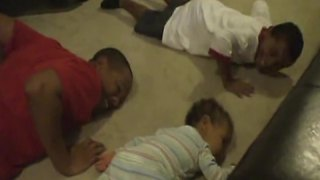 Baby Boy Doing Push Ups With His Older Brothers