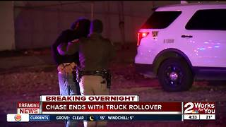 Police chase ends with truck rollover - Video