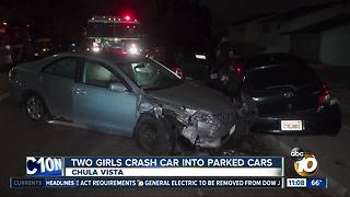 Two girls crash car into parked cars - Video