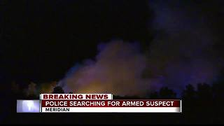 Search for armed suspect - Video