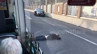 Nottingham man lying still on the middle of road shocks bus passengers