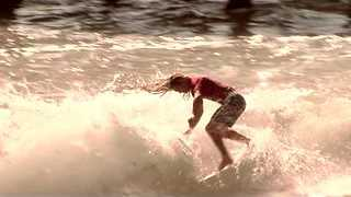 Surfers Hit Some Waves in Style - Video