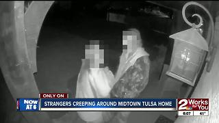 Woman catches strangers snooping around home - Video