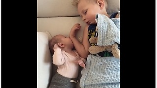 Soothing Baby Sister Puts Her Big Brother To Sleep