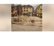River Swells Dangerously Over Bridge in North Italian Town of Garessio - Video