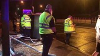 Car Crashes Into Bus Stop Amid Heavy Rainfall in Ryde - Video