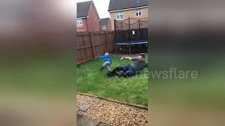 Hilarious moment UK dad slide tackles 4-year-old son - Video
