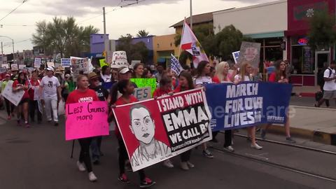 Students hold 'I stand with Emma' sign at Tucson rally