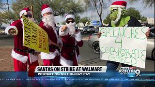 Santas on strike outside local Walmart - Video