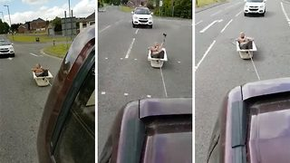Watch: Drinker dodges traffic in bath tied to back of car after falling asleep in tub - Video