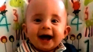 Cute baby laughing hysterically at mommy's hands  - Video