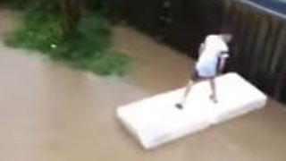 Boys Ride Mattress Through Post-Quake Flooded Wellington - Video