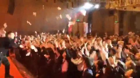 Workers go wild as cash is thrown around in company's party