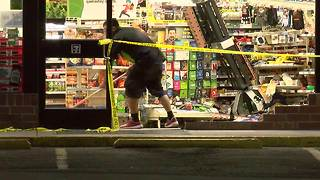 7-Eleven store clerk dances as he cleans mess from car crash - Video