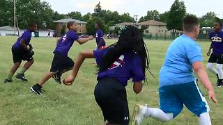 Flag football league teaching kids about the game