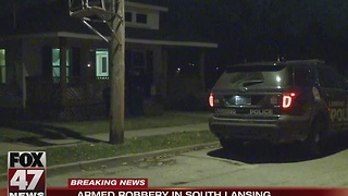 Police search for two men after armed robbery in Lansing - Video