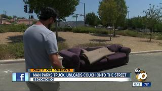 Caught on video: man leaves couch in street - Video