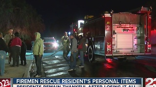 Firemen rescue resident''s personal items - Video