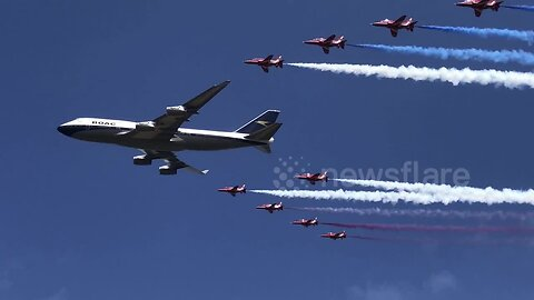 Flypast of a 747 in historic BOAC livery, alongside the Red Arrows