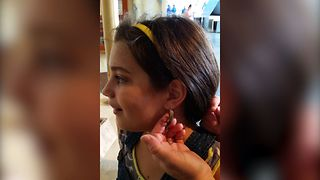 Girl Gets A Lizard Earring