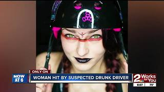 Woman saves friend hit by suspected drunk driver - Video