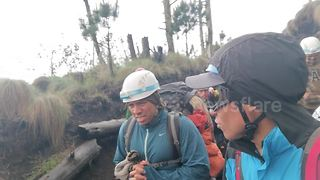 'They actually hurt': Rescuers pelted with rocks from Guatemala's volcanic eruption - Video