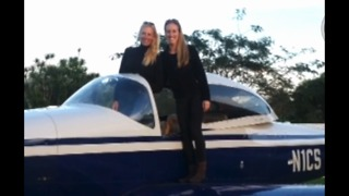 Local woman competing in a women's cross country air race - Video