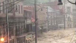 Floodwaters Rage Through Maryland Street as State of Emergency Declared - Video