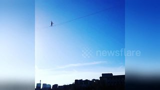 French slackliner walks from Eiffel Tower in Paris - Video