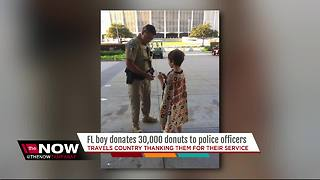 Florida boy donates 30,000 donuts to police officers - Video