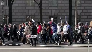 Thousands of Students March Past Trump International Hotel in Washington DC - Video