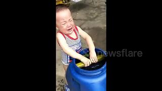 Baby cries when he can't get cucumber out of bucket - Video