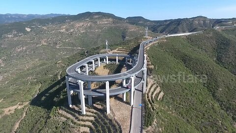 Spectacular drone footage of 3-storey highway built along China's Tianlong Mountain
