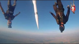 Skydivers jump with a missile
